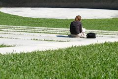 Studying Between Classes 2. A woman studies in an otherwise empty outdoor theater while awaiting her next class Royalty Free Stock Images
