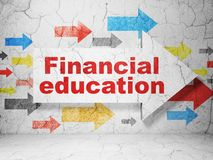 Studying concept: arrow with Financial Education on grunge wall background. Studying concept:  arrow with Financial Education on grunge textured concrete wall Stock Photos