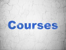 Studying concept: Courses on wall background. Studying concept: Blue Courses on textured concrete wall background Stock Photo