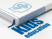 Studying concept: book Head With Gears, Kids Education on white background. Studying concept: closed book with Blue Head With Gears icon and text Kids Education Stock Image