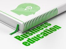 Studying concept: book Head With Light Bulb, Business Education on white background. Studying concept: closed book with Green Head With Light Bulb icon and text Stock Photos