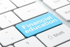 Studying concept: Financial Education on computer keyboard background. Studying concept: computer keyboard with word Financial Education, selected focus on enter Royalty Free Stock Photography