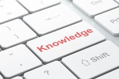 Studying concept: Knowledge on computer keyboard background Stock Images