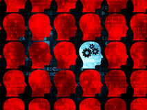 Studying concept: head with gears icon on Digital. Studying concept: rows of Pixelated red head icons around blue head with gears icon on Digital background, 3d Royalty Free Stock Photography