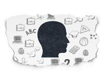 Studying concept: Head on Torn Paper background. Studying concept: Painted black Head icon on Torn Paper background with  Hand Drawn Education Icons Royalty Free Stock Photography