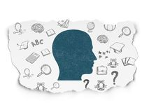 Studying concept: Head on Torn Paper background. Studying concept: Painted blue Head icon on Torn Paper background with  Hand Drawn Education Icons Stock Photo