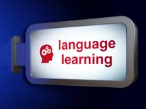 Studying concept: Language Learning and Head With Gears on billboard background. Studying concept: Language Learning and Head With Gears on advertising billboard Royalty Free Stock Photos