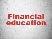 Studying concept: Financial Education on wall background. Studying concept: Red Financial Education on textured concrete wall background Royalty Free Stock Photo