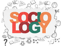Studying concept: Sociology on Torn Paper background Royalty Free Stock Images