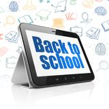 Studying concept: Tablet Computer with Back to School on display. Studying concept: Tablet Computer with  blue text Back to School on display,  Hand Drawn Stock Photography