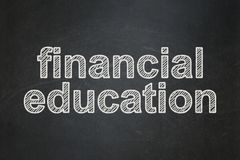 Studying concept: Financial Education on chalkboard background. Studying concept: text Financial Education on Black chalkboard background Royalty Free Stock Photo