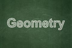 Studying concept: Geometry on chalkboard background. Studying concept: text Geometry on Green chalkboard background Stock Image