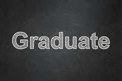 Studying concept: Graduate on chalkboard background. Studying concept: text Graduate on Black chalkboard background Royalty Free Stock Photography