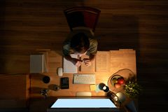 Studying at desk at night Royalty Free Stock Images
