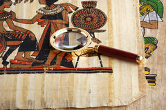 Studying of the Egyptian papyrus. Papyrus with elements of egyptian ancient history under magnifier. Variant four Stock Images