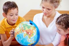 Studying geography Stock Photo