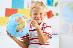 Studying geography Stock Images