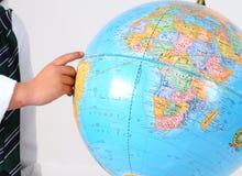 Studying the globe Stock Image