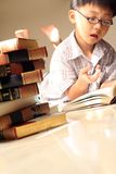 Studying hard. Very cute kid studying at home stock photo