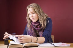 Studying Hard. Pretty, young woman studying in a home environment Stock Photography