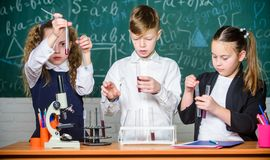 Studying hard. Lab microscope. childrens day. Chemistry microscope. students doing biology experiments with microscope stock photography