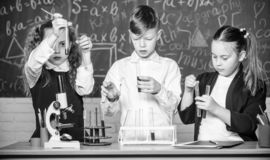 Studying hard. Lab microscope. childrens day. Chemistry microscope. students doing biology experiments with microscope stock photo