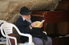 Studying Hebrew Holy Book. An aged man studies Jewish holy book next to the Western wall in Jerusalem, Israel, on the 10th of November, 2010 Royalty Free Stock Image