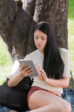 Studying with ipad on park Stock Image