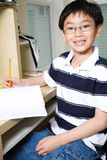 Studying kid. A shot of an asian kid studying at home Royalty Free Stock Photo