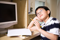 Studying kid. A shot of an asian kid studying at home Royalty Free Stock Images