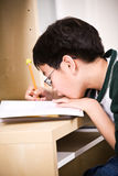 Studying kid. A shot of an asian kid studying at home Royalty Free Stock Photography