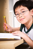 Studying kid. A shot of an asian kid studying at home Stock Photography