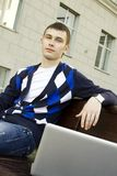 Studying with a laptop on campus Stock Photography