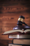 Studying law concept. Judge`s gavel on top of open books , on old wood background Royalty Free Stock Photo