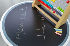 Studying Math with Abacus. All the help is welcome when studying math Royalty Free Stock Image