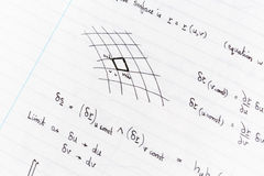 Studying math. Surface integration equations and diagram handwritten on lined paper stock photography