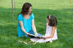 Studying with mum outdoor Royalty Free Stock Images