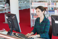 Studying online on a computer at Library Stock Photos