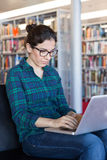 Studying online on a Laptop at Library Royalty Free Stock Photos