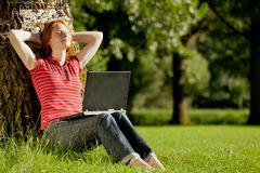 Studying outdoors Stock Image