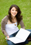 Studying outdoors Stock Images