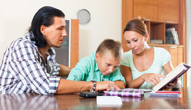 Studying with parents Stock Photos