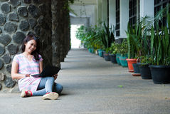 Studying in a park Stock Photography