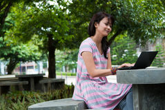 Studying in a park Stock Photos