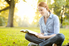 Studying in a Park at Sunset Royalty Free Stock Photo