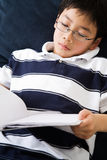 Studying student. A shot of an asian kid studying at home Stock Images