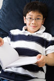 Studying student. A shot of an asian kid studying at home Stock Photo