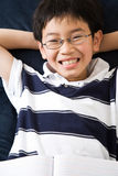 Studying student. A shot of an asian kid studying at home Royalty Free Stock Photography