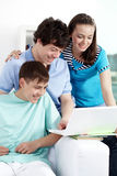 Studying teens. Three teenagers studying with computer Royalty Free Stock Image