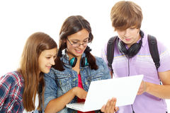 Studying teens. Three teenagers studying with computer Royalty Free Stock Photography
